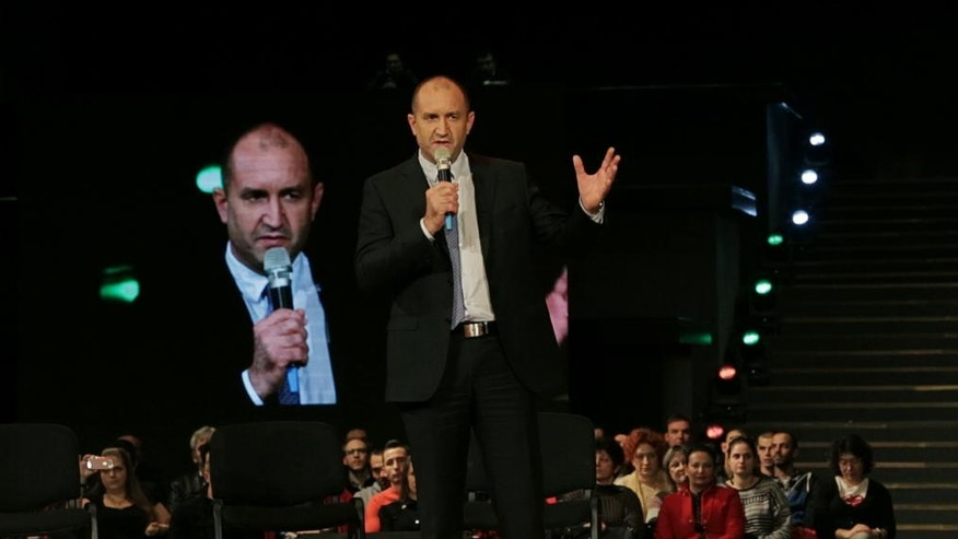 This photo taken on Tuesday, Nov. 1, 2016  Bulgaria's Socialist party presidential candidate Rumen Radev speaks during his pre-election campaign in Sofia. Bulgarians will to choose their new president on Sunday to replace incumbent Rosen Plevneliev after his five-year term ends next January. The election campaign focused mainly on the future of the European Union, relations with Russia and the threats from a possible rise in migrant inflows from neighboring Turkey(AP Photo/Valentina Petrova)