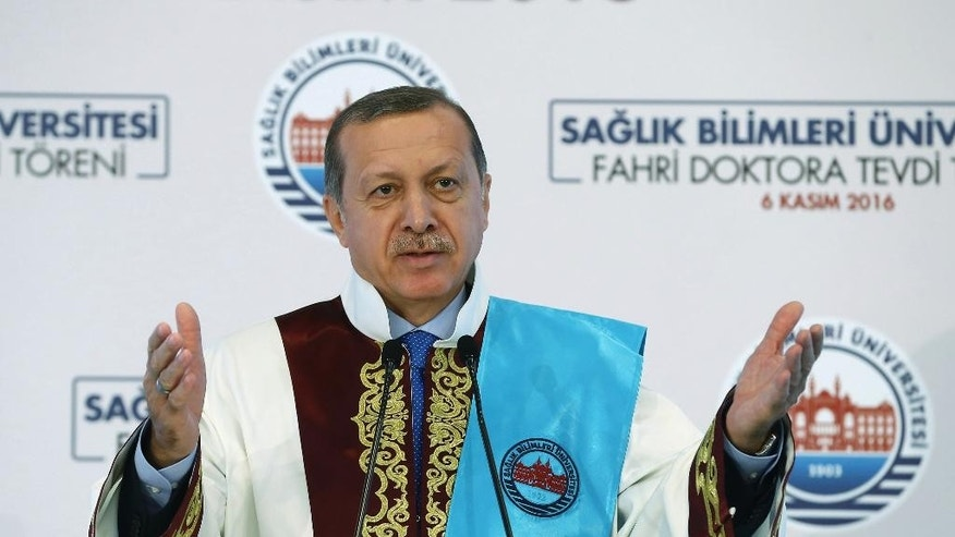 Turkey's President Minister Recep Tayyip Erdogan speaks after he received a honorary doctorate from Medical Sciences University in Istanbul, Sunday, Nov. 6, 2016. Erdogan says Sunday allied Syrian opposition fighters are fast approaching the Syrian town of al-Bab, a stronghold of the Islamic State group. (Kayhan Ozer/Pool photo via AP)