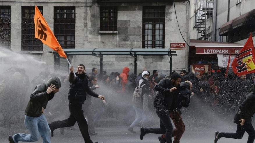 Riot police use water cannons to disperse people protesting the detentions of 12 lawmakers from pro-Kurdish Peoples' Democratic Party, or HDP, in Istanbul, Saturday, Nov. 5, 2016. (AP Photo/Cagdas Erdogan)
