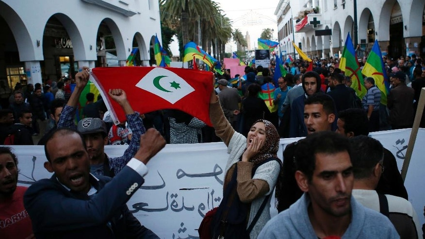 People hold the North Republic Flag in Rabat, Morocco, Sunday Nov. 6, 2016 and gather to mark a week after the death of fish vendor Mouhcine Fikri, who was crushed in a garbage truck. Protests have been taking place in Morocco since last Friday. (AP Photo/Abdeljalil Bounhar)