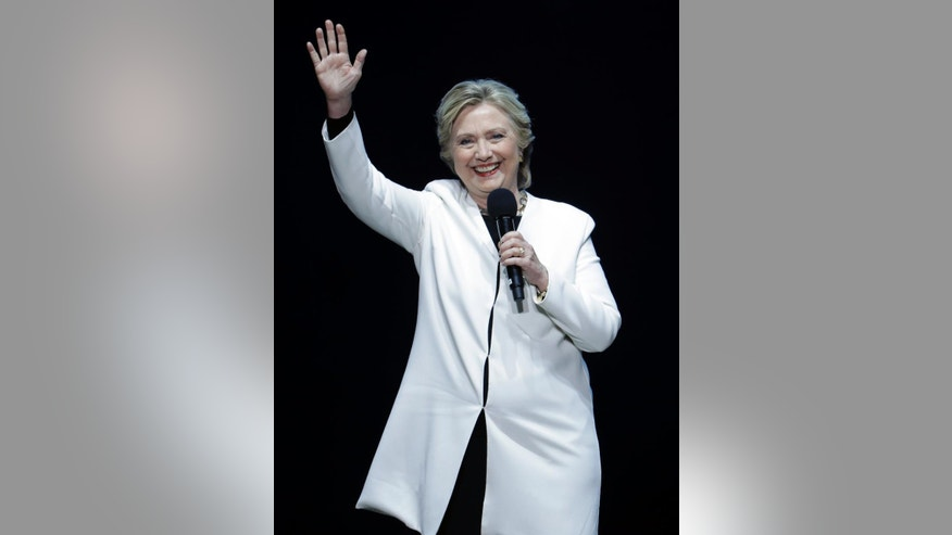 Democratic presidential candidate Hillary Clinton speaks during a concert hosted by musician Katy Perry, Saturday, Nov. 5, 2016, at the Mann Center for the Performing Arts in Philadelphia. (AP Photo/Julio Cortez)
