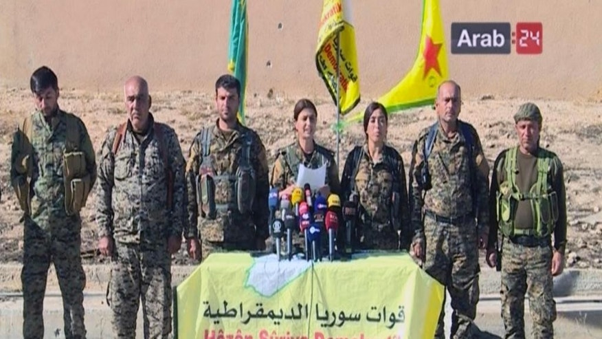 "This frame grab from video provided by Arab 24 network, shows officials with the U.S.-backed Syria Democratic Forces at a press conference in Ein Issa in northern Syria. U.S.-backed Kurdish-led Syrian forces announced their plan Sunday to retake the Islamic State group's de facto capital of Raqqa, saying they hoped Turkey would not ""interfere in internal Syrian affairs."" (Arab 24 network, via AP)"