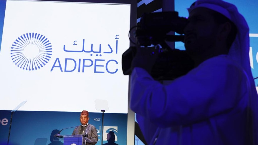 An Emirati journalist films the audience as OPEC Secretary-General Mohammad Sanusi Barkindo of Nigeria gives a speech at the annual Abu Dhabi International Petroleum Exhibition & Conference in Abu Dhabi, United Arab Emirates, on Monday, Nov. 7, 2016. Those attending the onference this week remain worried about low global oil prices. (AP Photo/Jon Gambrell)