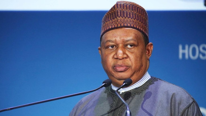 OPEC Secretary-General Mohammad Sanusi Barkindo of Nigeria gives a speech at the annual Abu Dhabi International Petroleum Exhibition & Conference in Abu Dhabi, United Arab Emirates, on Monday, Nov. 7, 2016. Those attending the conference this week remain worried about low global oil prices. (AP Photo/Jon Gambrell)