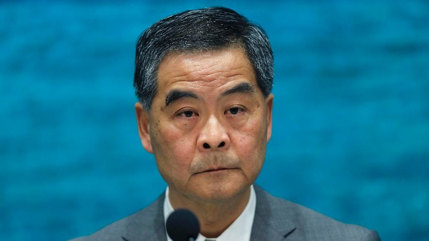 Hong Kong Chief Executive Leung Chun-ying listens to reporters questions during a press conference at the government headquarters in Hong Kong, Monday, Nov. 7, 2016. Hong Kong's Beijing-backed leader, Chief Executive Leung, says he will implement the Chinese legislative panel's ruling that bars two democratically elected separatist lawmakers from taking office in Hong Kong. (AP Photo/Vincent Yu)