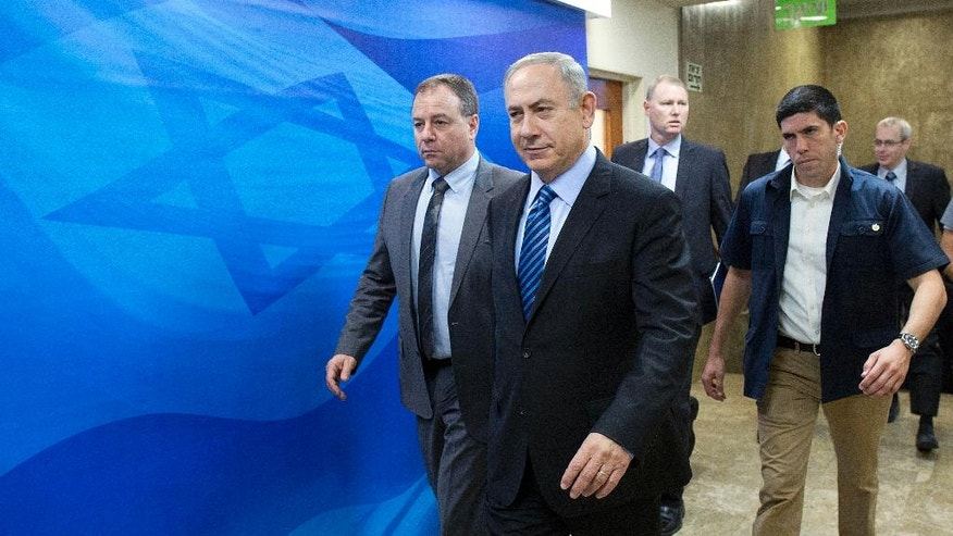 Israeli Prime Minister Benjamin Netanyahu, center, arrives for the weekly cabinet meeting, at his office, in Jerusalem, Sunday, Nov. 6, 2016. (Abir Sultan, via AP)
