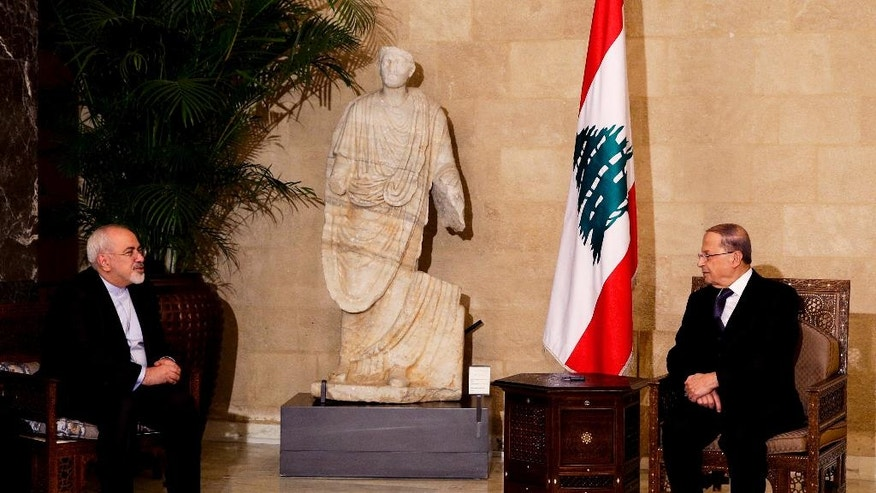 Lebanon's newly elected President Michel Aoun, right, meets with Iranian Foreign Minister Mohammad Javad Zarif at the presidential palace in Baabda, east of Beirut, Lebanon, Monday, Nov. 7, 2016. (AP Photo/Hassan Ammar)