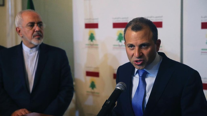 Lebanese Foreign Minister Gibran Bassil, right, speaks during a joint press conference with his Iranian counterpart Mohammad Javad Zarif, left, in Beirut, Lebanon, Monday, Nov. 7, 2016. Zarif is in Beirut for two visit to congratulate newly elected president Michel Aoun and to meet with other Lebanese officials. (AP Photo/Hussein Malla)