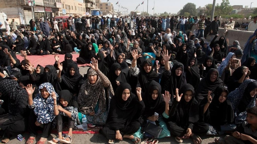 Pakistani Shiite Muslims attend a sit in protest, in Karachi, Pakistan, Monday, Nov. 7, 2016. A Pakistani counter-terrorism police officer says several Sunni and Shiite Muslim leaders have been detained in a probe over recent sectarian attacks in the southern port city of Karachi. (AP Photo/Shakil Adil)
