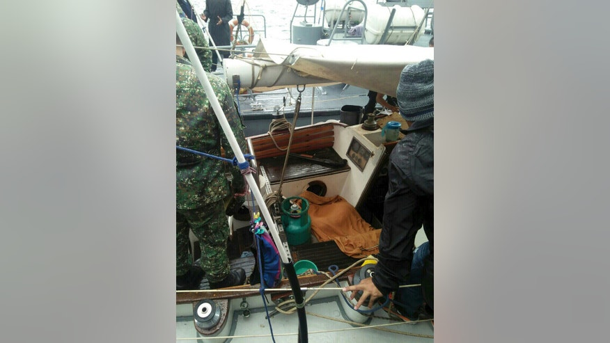 """In this photo provided by Armed Forces of the Philippines Western Mindanao Command (WESMINCOM) and authorized for distribution by Army Maj. Filemon Tan Jr. Monday, Nov. 7, 2016, Philippine Navy crew board a yacht named """"Rockall"""" after being found abandoned off the Sulu Sea in southern Philippines over the weekend. The Philippine military is verifying a claim by Abu Sayyaf militants that they have kidnapped a German man from the yacht and shot and killed his female companion, whose suspected body was found in the abandoned boat in the southern Philippines, military officials said Monday. Regional military spokesman Maj. Filemon Tan said Abu Sayyaf spokesman Muamar Askali had claimed the militants kidnapped Juegen Kantner and killed his companion while the couple were cruising off neighboring Malaysia's Sabah state. (WESMINCOM via AP)"""
