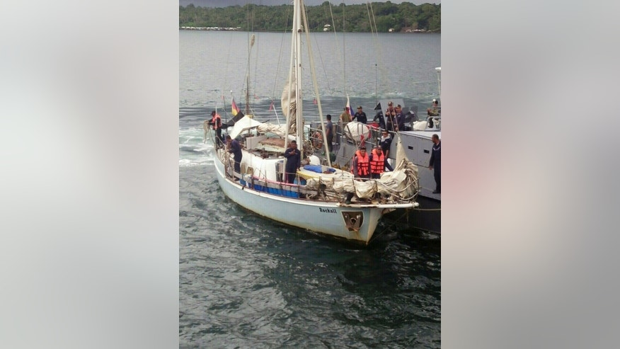 """In this photo provided by the Armed Forces of the Philippines Western Mindanao Command (WESMINCOM) and authorized for distribution by Army Maj. Filemon Tan Jr. on Monday, Nov. 7, 2016, Philippine Navy crew board a yacht named """"Rockall"""" after it was found abandoned off the Sulu Sea in southern Philippines over the weekend. The Philippine military is verifying a claim by Abu Sayyaf militants that they have kidnapped a German man from the yacht and shot and killed his female companion, whose body was apparently found on the boat, military officials said Monday. Regional military spokesman Maj. Filemon Tan said Abu Sayyaf spokesman Muamar Askali had claimed the militants kidnapped Juegen Kantner and killed his companion while the couple were cruising off neighboring Malaysia's Sabah state. (WESMINCOM via AP)"""