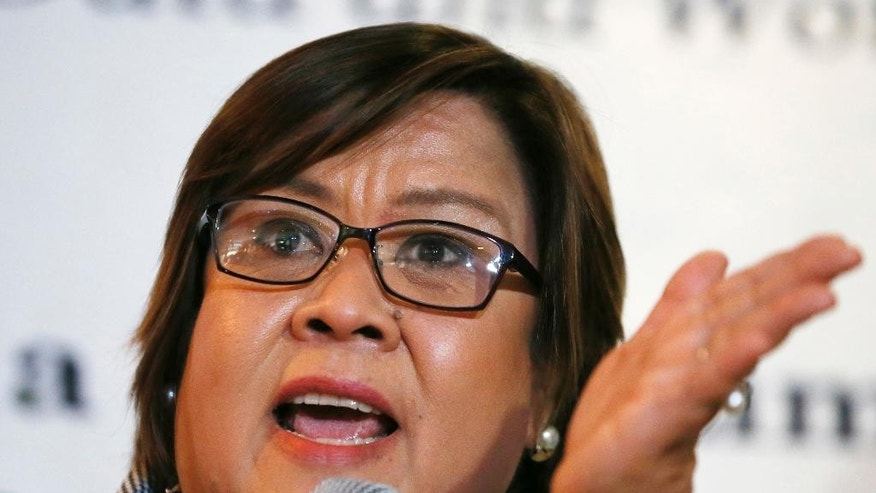 "Opposition Senator Leila De Lima gestures during a news conference following her filing a petition to stop President Rodrigo Duterte ""from securing private details about her personal life and using them to degrade her dignity as a human being, a woman and a senator"" Monday, Nov. 7, 2016 in Manila, Philippines. Senator De Lima claimed that the verbal attacks and threats leveled against her are not covered by presidential immunity from suit because ""they are not the official acts of a President."" (AP Photo/Bullit Marquez)"
