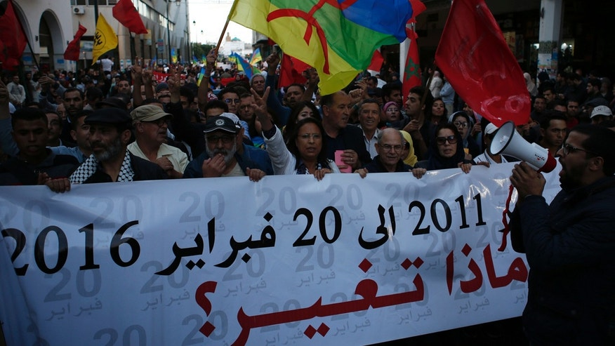 People hold Amazigh flags and Moroccan flags in Rabat, Morocco, Friday Nov. 6, 2016, and mark a week after the death of fish vendor Mouhcine Fikri, who was crushed in a garbage truck.