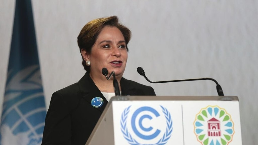 U.N. climate chief Patricia Espinosa delivers her speech during the opening session of the Climate Conference in Marrakech, Morocco, Monday Nov. 7, 2016. Climate negotiators have started work on implementing the Paris pact on global warming amid uncertainty over how the U.S. election will impact the landmark deal as temperatures and greenhouse gases soar to new heights. (AP Photo/Mosa'ab Elshamy)