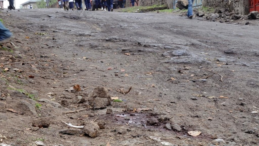 Blood stains on a gravel road, after a blast on the outskirts of Goma, Democratic Republic of Congo, Tuesday, Nov. 8, 2016. A grenade detonated where a group of Indian peacekeepers were exercising on Tuesday morning in eastern Congo, killing at least two people and sparking an angry demonstration that was dispersed by tear gas, officials and witnesses said. One peacekeeper and one 8-year-old child were killed in the blast on the outskirts of Goma, the capital of North Kivu province, said provincial governor Julien Paluku. (AP Photo/Al-hadji Kudra Maliro)