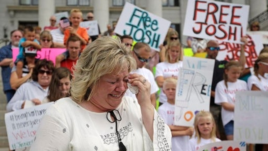 Laurie Holt, mother of Josh Holt, cries during a rally at the Utah State Capitol on July 30, 2016.