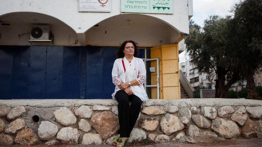In this photo taken Thursday, Nov. 3, 2016, Israeli Arab social worker, Samah Salaime, poses for a photograph in Lod, central Israel.  A string of murders of Israeli-Arab women by suspected  relatives has sparked soul searching in the community and unprecedented demonstrations against its treatment of women. After years of silence, Arab citizens are now calling for more police and social services in their long-neglected neighborhoods. (AP Photo/Dan Balilty)
