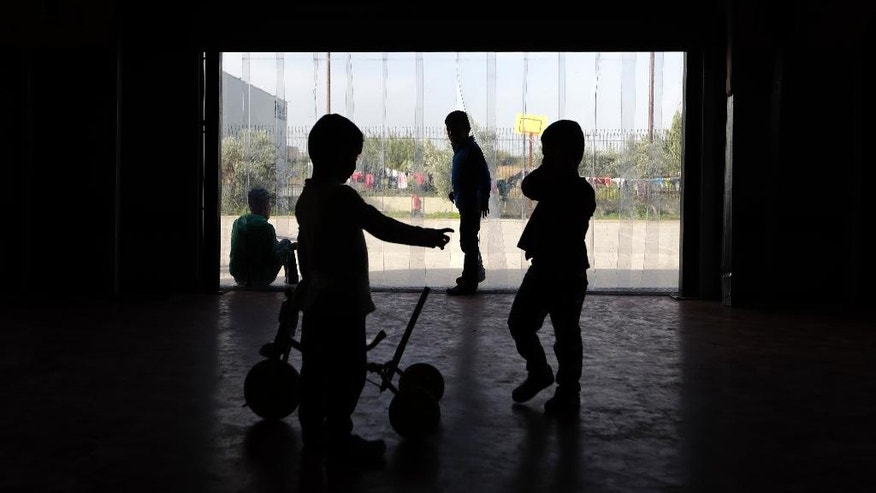 Children play inside a building at the Kalochori refugee camp, set up in a disused supermarket, on the outskirts of the northern Greek city of Thessaloniki on Tuesday, Nov. 8, 2016. More than 60,000 refugees are stranded in Greece, unable to continue their journeys northward to more prosperous European Union countries after Balkan countries shut down their land borders to refugees earlier this year. (AP Photo/Thanassis Stavrakis)