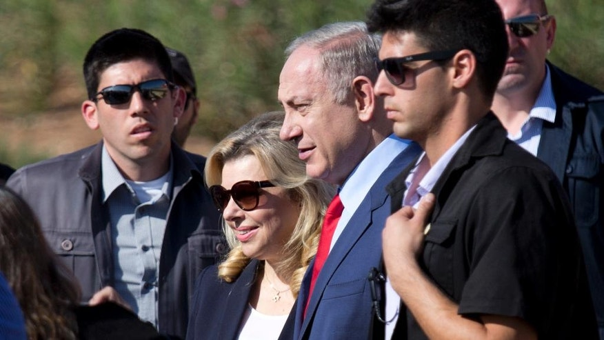 Israeli Prime Minister Benjamin Netanyahu, third from right, and his wife Sara attend an inauguration ceremony of Hahemek rail line in the train station in Afula, Israel, Tuesday, Nov. 8, 2016. (AP Photo/Ariel Schalit)