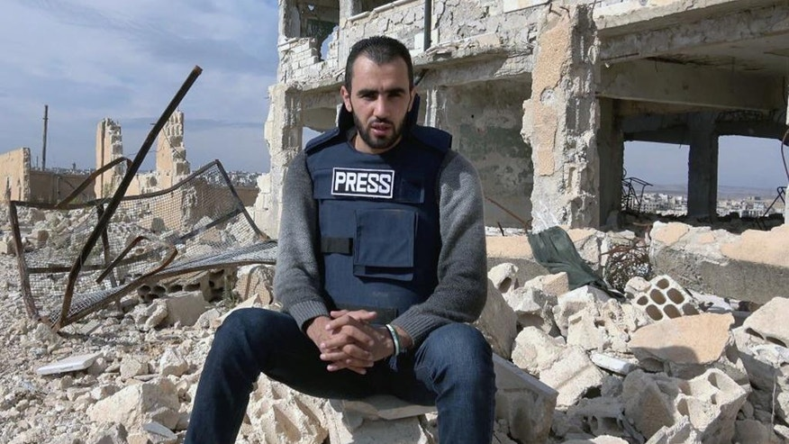 In this Sunday, Nov. 6, 2016, Hadi Abdullah poses for a photograph in Maaret al-Numan in Idlib province, Syria. The international reporting organization Reporters Without Borders named Abdullah as Reporter of the Year for 2016. Abdullah, from Homs, Syria, reports from opposition controlled territory in Syria. He was injured in a blast that killed his cameraman, Khaled al-Issa, in June. (Courtesy of Abdullah, via AP)