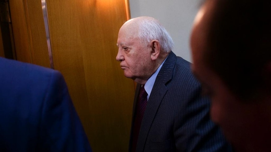 FILE - In this Feb. 29, 2016 file photo, former Soviet leader Mikhail Gorbachev is helped by an aide as he leaves after the launch ceremony for a book about him in Moscow, Russia. Gorbachev, 85, was in a Moscow hospital for a scheduled operation on Wednesday, Nov. 9, 2016. (AP Photo/Ivan Sekretarev, File)
