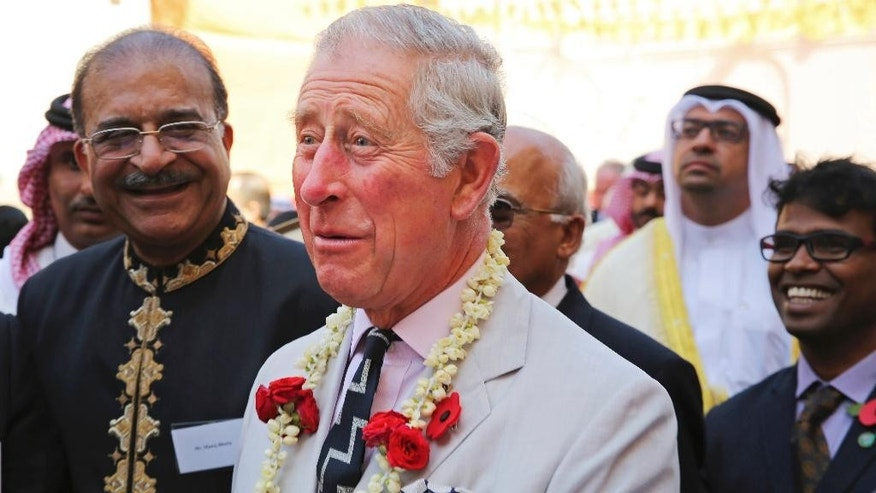 Britain's Prince Charles reacts to a joke at a Hindu temple in Manama, Bahrain, on Thursday, Nov. 10, 2016. Prince Charles and his wife Camilla are on a three-nation tour of the Gulf. (AP Photo/Jon Gambrell)