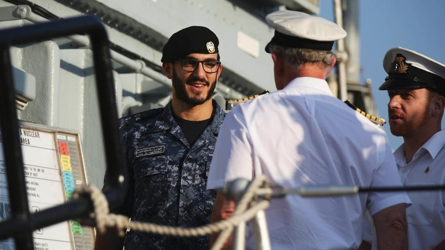 Isa bin Salman Al Khalifa, the son of Bahraini Crown Prince Salman bin Hamad bin Isa Al Khalifa, greets Prince Charles aboard the HMS Middleton docked at Britain's under-construction Mina Salman Support Facility in Manama, Bahrain, on Thursday, Nov. 10, 2016. Prince Charles and his wife Camilla are touring Bahrain but their visit come amid criticism of the island nation conducting a fierce crackdown on dissent. (AP Photo/Jon Gambrell)