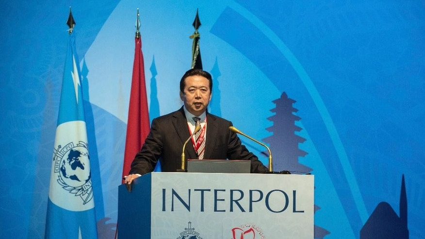 In this photo released by Xinhua News Agency, China's Vice Minister of Public Security Meng Hongwei delivers a campaign speech at the 85th session of the general assembly of the International Criminal Police Organization (Interpol), in Bali, Indonesia, Nov. 10, 2016. The top Chinese police official was elected president of Interpol on Thursday, setting off alarm bells among rights advocates over the legitimization of abuses and lack of transparency within China's legal system. (Du Yu/Xinhua via AP)