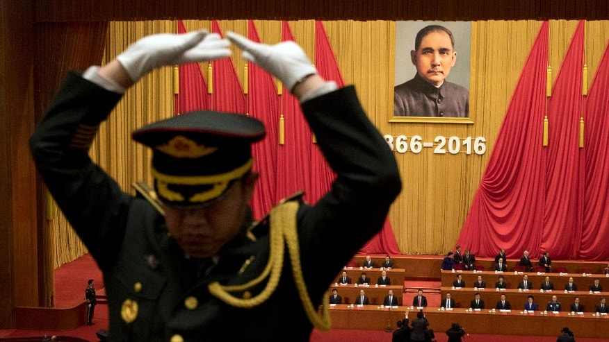 A band conductor leads a military band as China's top leaders arrive for a commemorative meeting held to mark the 150th anniversary of the birth of Sun Yat-sen, founding father of the Republic of China and founder of the Chinese National Party (KMT) at the Great Hall of the People in Beijing, China, Friday, Nov. 11, 2016. (AP Photo/Ng Han Guan)