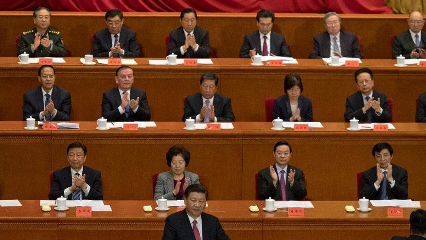 Chinese President Xi Jinping speaks at the commemorative meeting to mark the 150th anniversary of the birth of Sun Yat-sen, founding father of the Republic of China and founder of the Chinese National Party (KMT) at the Great Hall of the People in Beijing, China, Friday, Nov. 11, 2016. (AP Photo/Ng Han Guan)