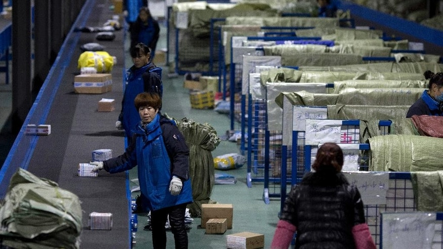Workers at the ZTO Express logistic delivery centre process packages one day before China's Singles Day, traditionally the busiest day for online shopping in Beijing, China, Thursday, Nov. 10, 2016.  China's so-called Singles Day, is traditionally the world's biggest online shopping day of the year, and this year is widely expected to be even busier than normal. (AP Photo/Ng Han Guan)