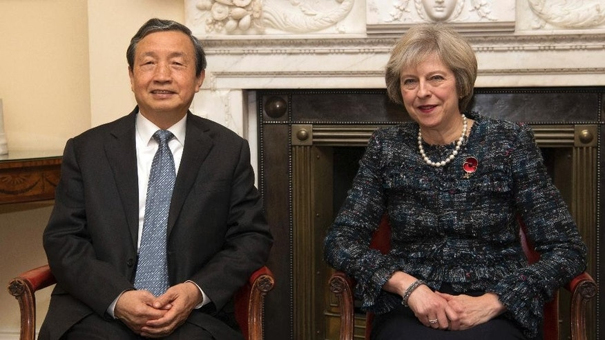 British Prime Minister Theresa May, right, sits with China's Vice Premier, Ma Kai, left, after he arrived at 10 Downing Street Wednesday, Nov. 9, 2016 in London. Ma Kai is in the United Kingdom to discuss a number of issues including bilateral trade. (Carl Court/Pool Photo via AP)