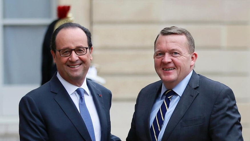 France's president Francois Hollande greets Danish Prime Minister Lars Lokke Rasmussen, pror to their meeting at the Elysee Palace in Paris, France, Thursday, Nov. 10, 2016. (AP Photo/Francois Mori)