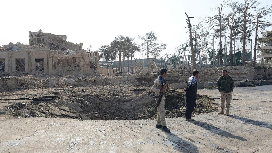 Afghan security personnel guard around an explosion crater near the German consulate in Mazar-i-Sharif, capital of northern Balkh province, Afghanistan, Friday, Nov. 11, 2016. The consulate was attacked by a suicide car bomber who rammed the compound, killing four people and wounding more than 100, police and a doctor said Friday. (AP Photos/Shiwa Kiyanosh)