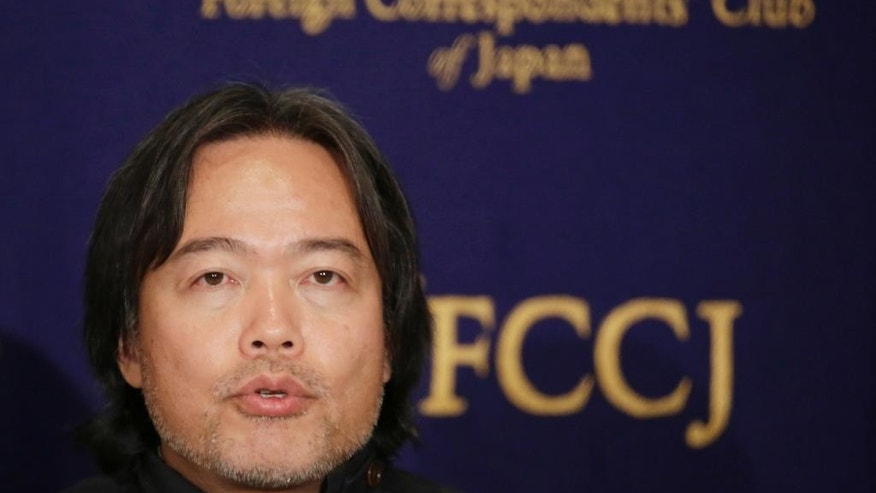 Kosuke Tsuneoka, a Japanese freelance journalist who was detained by local authorities in Iraq, speaks during a press conference in Tokyo, Thursday, Nov. 10, 2016. Tsuneoka was released Monday, Nov. 7 after being suspected of being a member of the Islamic State group. (AP Photo/Eugene Hoshiko)