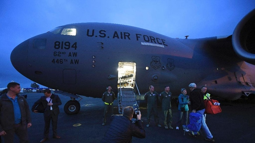 U.S. Secretary of State John Kerry, right, prepares to board U.S. Air Force C-17 flight to Antarctica at Christchurch International Airport, New Zealand Friday, Nov. 11, 2016.  The State Department said Friday that Kerry would travel from Nov. 10 to Nov. 12 to the McMurdo research station on Antarctica's Ross Island and the South Pole. Kerry will be the first secretary of state and highest-ranking U.S. official to visit Antarctica. (Mark Ralston/Pool Photo via AP)