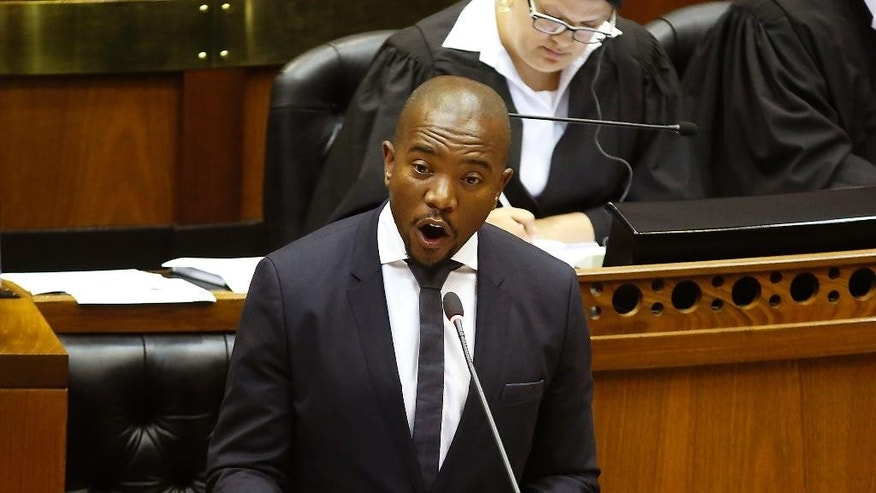 South African DA, Democratic Alliance party leader, Mmusi Maimane, calls for a motion to remove South African President Jacob Zuma as President at Parliament in Cape Town, South Africa, Thursday, Nov. 10, 2016. South Africa's parliament is debating a motion to remove President Jacob Zuma because of a series of scandals, including possible government corruption linked to the president and some associates. (AP Photo/Schalk van Zuydam)