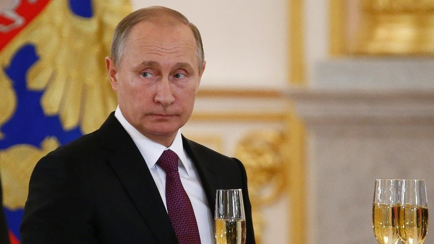 In this Nov. 9, 2016, photo, Russian President Vladimir Putin makes a toast during a ceremony for receiving diplomatic credentials from foreign ambassadors in the Kremlin in Moscow, Russia. In careful phrasing befitting the spy he once was, Vladimir Putin has made it clear he expects a great deal from President-elect Donald Trump. And, the billionaire businessman may expect a transactional relationship with Putin. (Sergei Karpukhin/Pool photo via AP)