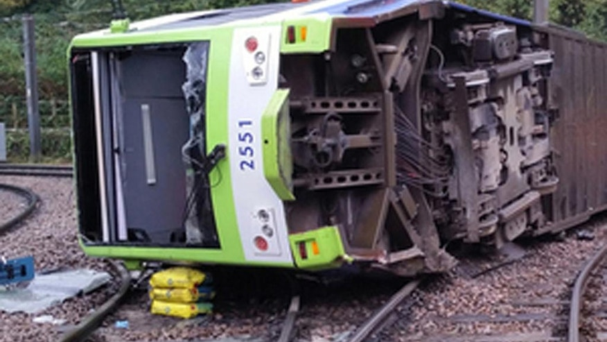 A photo issued by the Rail Accident Investigation Branch of the tram which derailed near the Sandilands stop in Croydon, London, Wednesday, Nov. 9, 2016. Several people were killed and more than 50 injured when a tram derailed in south London during a heavy rainstorm before dawn Wednesday, police said. Emergency workers worked for hours to free five people trapped in the wreckage of the two-carriage tram that tipped on its side next to an underpass. (RAIB via AP)