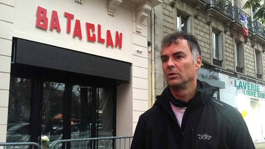 In this photo dated Monday Nov. 7, 2016, Denys Plaud, 48, a Bataclan survivor who was teaching maths and physics, answers questions during an interview with the Associated Press in front of the Bataclan concert hall in Paris, France. One year on, survivors of France's deadliest extremist attacks are trying to look to the future, but they will never forget. (AP Photo/Oleg Cetinic)
