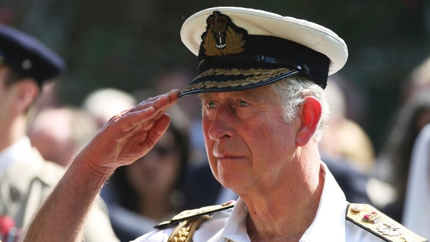 "Britain's Prince Charles salutes during a remembrance ceremony in Manama, Bahrain, on Friday, Nov. 11, 2016. A leader in Bahrain's secular opposition told The Associated Press on Friday he fears a royal visit by Britain's Prince Charles and his wife Camilla could ""whitewash"" an ongoing crackdown on dissent in the tiny island nation. (AP Photo/Jon Gambrell)"