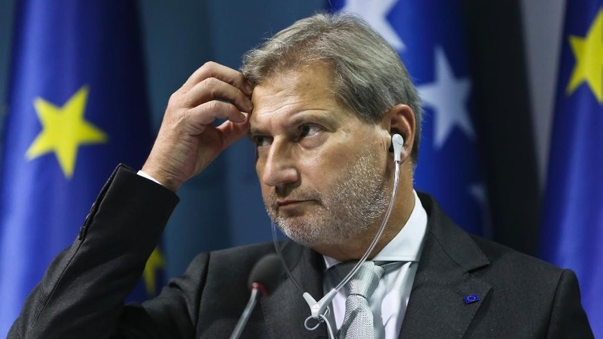 EU's Commissioner for European Neighbourhood Policy and Enlargement Negotiations Johannes Hahn, gestures during a press conference while on his one day official visit to Kosovo Friday, Nov. 11, 2016. (AP Photo/Visar Kryeziu)