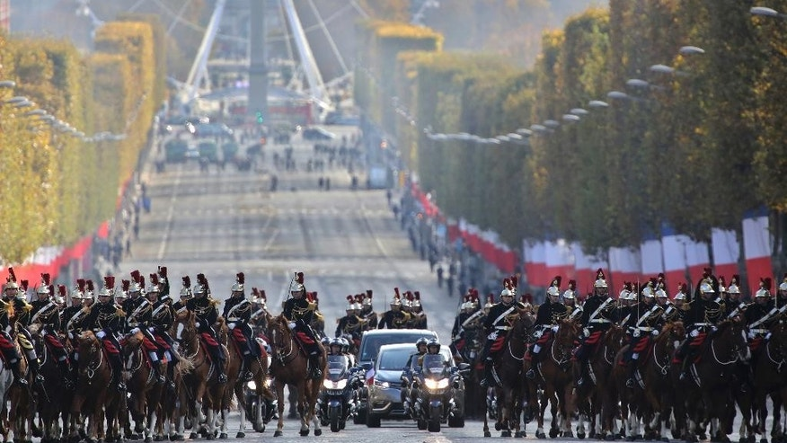 The French President's car arrives on the Champs Elysee Avenue prior to the Armistice Day ceremonies marking the end of World War I, in Paris, France, Friday, Nov. 11, 2016. (AP Photo/Thibault Camus, Pool)