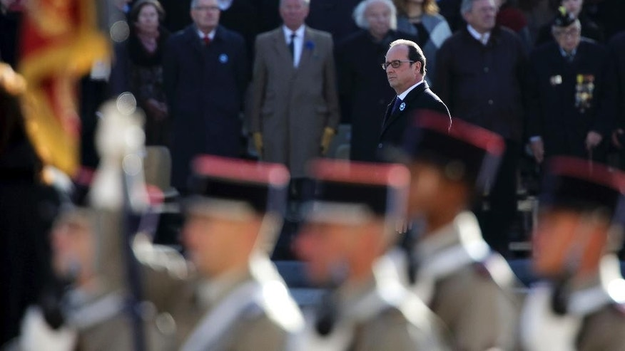 France's President Francois Hollande arrives to lay a wreath of flowers at the Tomb of the Unknown soldier under the Arc de Triomphe during the Armistice Day ceremonies marking the end of World War I, in Paris, France, Friday, Nov. 11, 2016. (AP Photo/Thibault Camus, Pool)