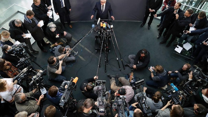 German Foreign Minister Frank-Walter Steinmeier, center, address the media prior to a meeting of the foreign committee of the German federal parliament in Berlin, Germany, Wednesday, Nov. 9, 2016. (AP Photo/Michael Sohn)