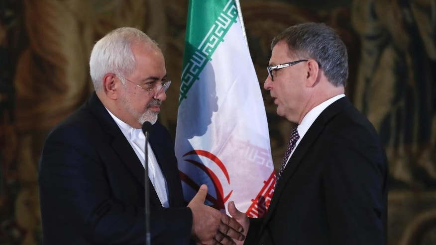 Czech Republic's Foreign Minister Lubomir Zaoralek, right, shakes hands with Iran's Foreign Minister Mohammad Javad Zarif left, after their joint press conference in Prague, Czech Republic, Friday, Nov. 11, 2016. (AP Photo/Petr David Josek)