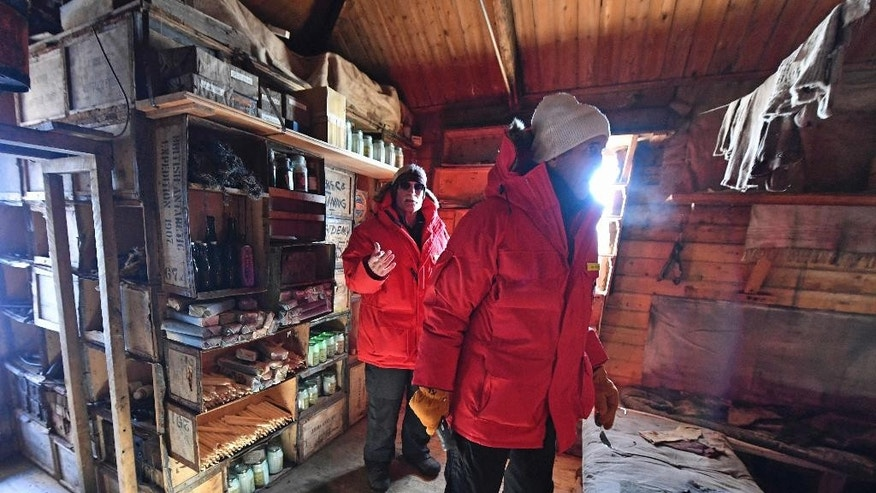 U.S. Secretary of State John Kerry, front, listens to Scott Borg, the head of the Polar Program for the National Science Foundation, as they visit the historic Shackleton hut during Kerry's visit to McMurdo Station in Antarctica Friday, Nov. 11, 2016. Kerry became the highest-ranking American official to visit Antarctica on Friday when he landed for a two-day trip during which he'll hear from scientists about the impact of climate change on the frozen continent. (Mark Ralston/Pool Photo via AP)