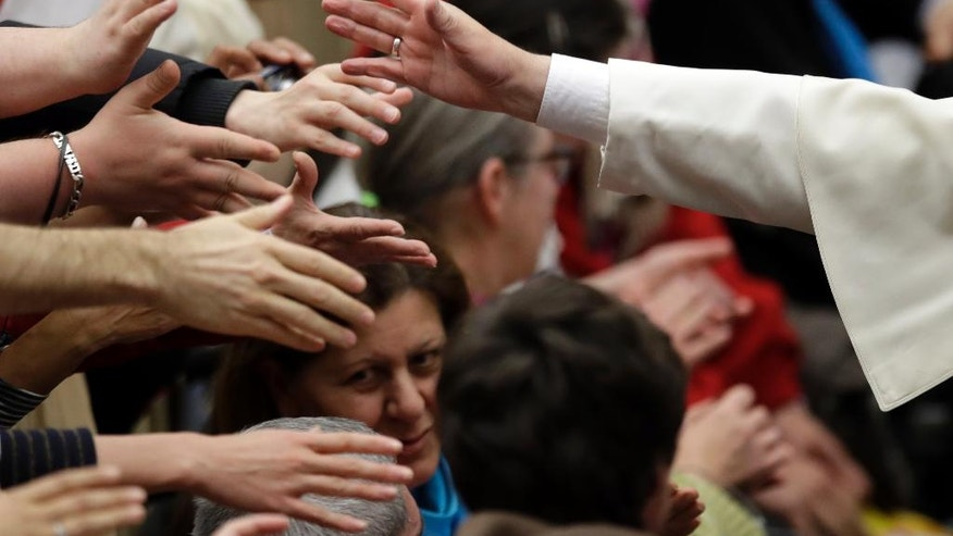 Pope Francis blesses faithful during an audience with the participants of homeless jubilee in the Paul VI Hall at the Vatican, Friday, Nov. 11, 2016. (AP Photo/Alessandra Tarantino)