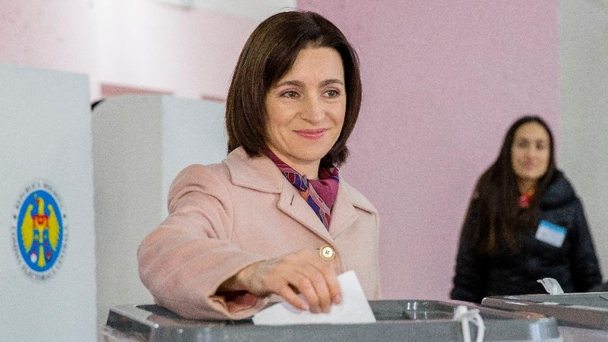 FILE - This is a Sunday, Oct. 30, 2016  file photo of the leader of the Action and Solidarity Party, Maia Sandu, as she casts her vote during the presidential elections in Chisinau Moldova. Moldovans will directly elect their president on Sunday Nov. 13, 2016 for the first time in 20 years. The favorite is Socialist Igor Dodon who wants the ex-Soviet republic to return to the Russian orbit. Rival Maia Sandu believes the agricultural nation of 3.5 million, bordering Ukraine and European Union member Romania, would secure a more prosperous future in Europe. (AP Photo/Roveliu Buga, File)