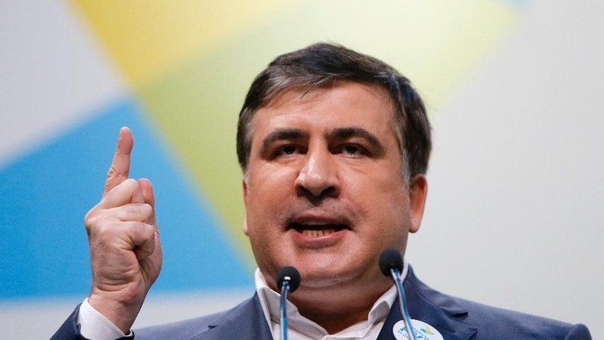 "FILE - In this Wednesday, Dec. 23, 2015 file photo, governor of Odessa region in Ukraine, Mikhail Saakashvili speaks during the anti-corruption forum in Kiev, Ukraine. Mikhail Saakashvili, the former Georgian president who has resigned as governor of Ukraine's Odessa region, says he will push for early elections in the country. Saakashvili said Friday, Nov. 11, 2016 that his goal is to hold ""early parliamentary elections as quickly as possible."" He said his political movement will team up with other opposition forces to unseat the current authorities. (AP Photo/Sergei Chuzavkov, File)"